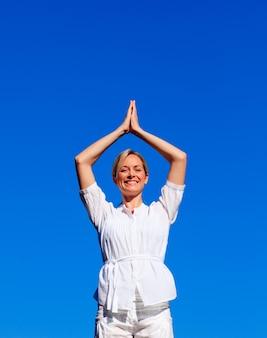 Smiling woman practising yoga