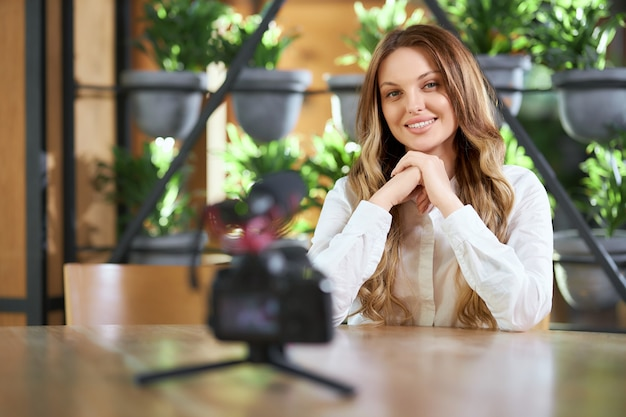 Smiling woman preparing for interview on camera