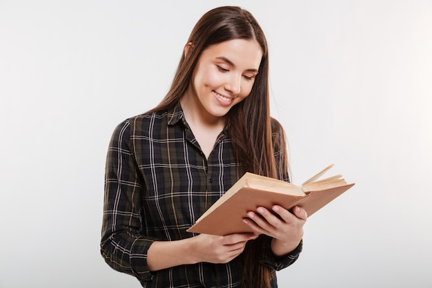 Smiling woman in shirt reading book