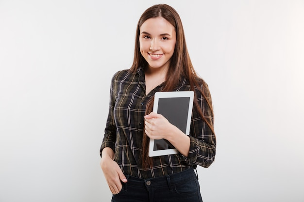 Smiling woman in shirt with tablet computer