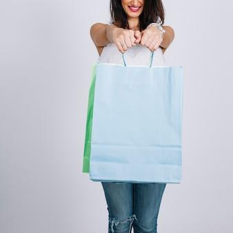 Smiling woman showing shopping bags