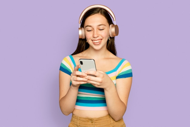 Smiling woman streaming music with smartphone digital device