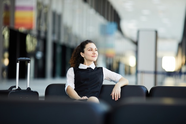 Smiling woman waiting in airport