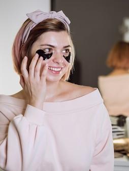 Smiling woman wearing face mask