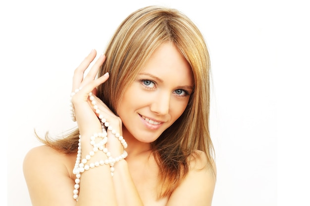 Smiling woman - white teeth and pearls isolated