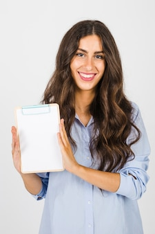 Smiling woman with clipboard