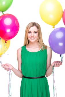 Smiling woman with colored balloons