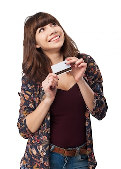 Smiling woman with a credit card