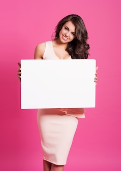 Smiling woman with empty whiteboard