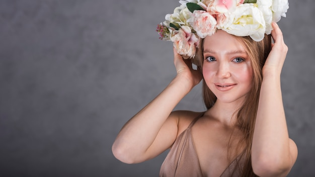 Smiling woman with flowers on head