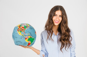 Smiling woman with globe