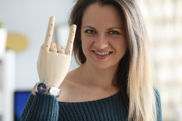 Smiling woman with prosthetic arm