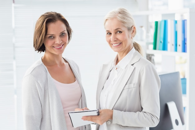 Smiling woman with therapist