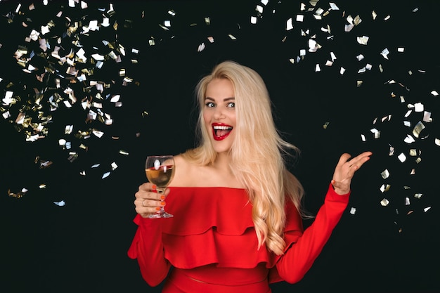 Smiling woman with wineglasses with champagne