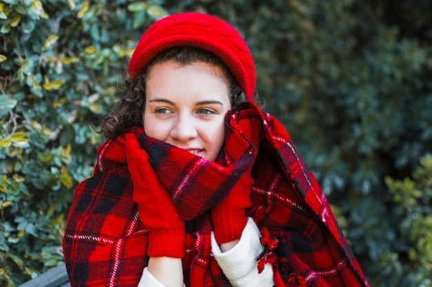 Smiling woman wrapping in scarf