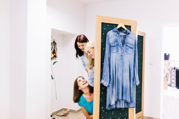Smiling women in fitting room