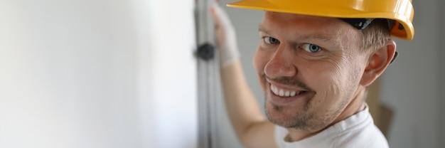 Smiling worker wearing helmet