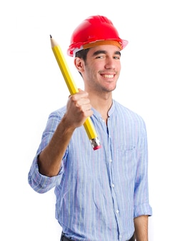 Smiling worker with safety helmet and pencil