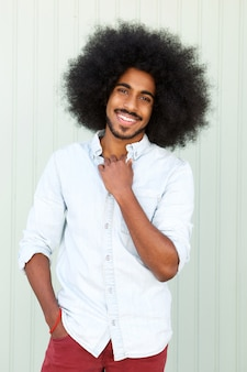 Smiling young african american man with afro