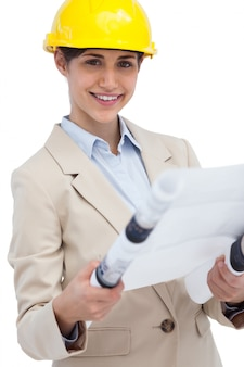 Smiling young architect holding plan