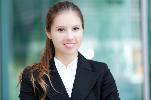 Smiling young business woman outdoor
