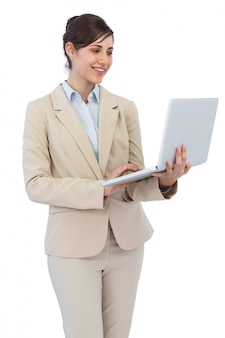 Smiling young businesswoman with laptop