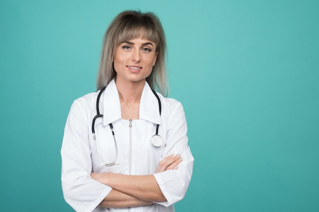 Smiling young female doctor with a stethoscope