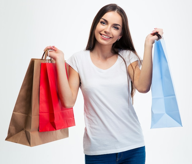 Smiling young girl holding shopping bags
