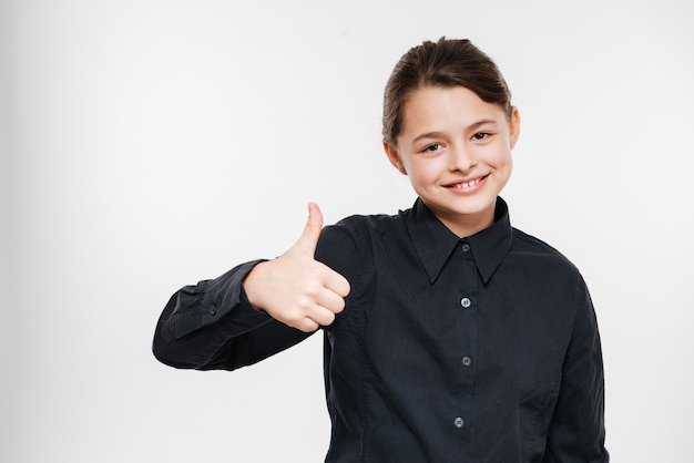 Smiling young girl make thumbs up gesture