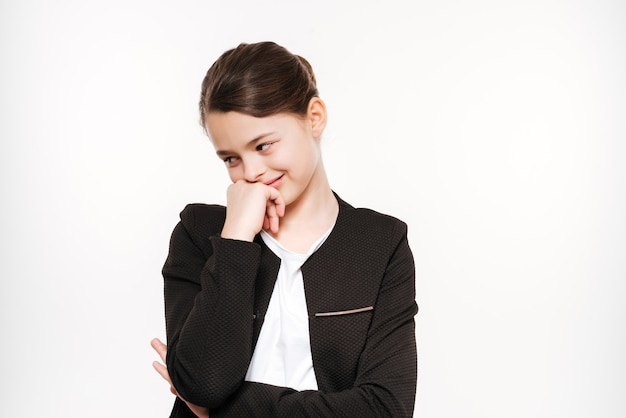 Smiling young girl standing and posing