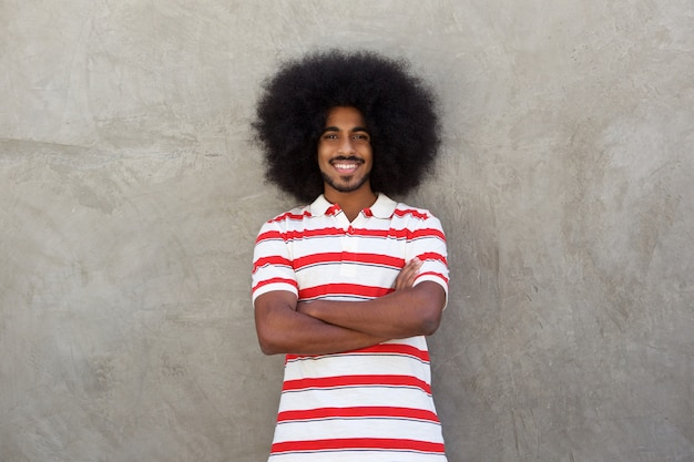 Smiling young man with afro and striped shirt