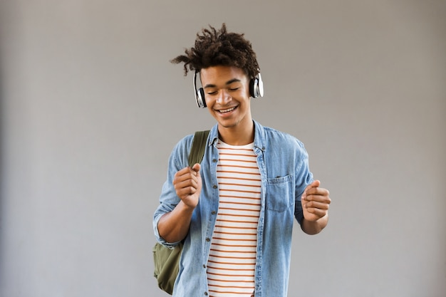Smiling young man with backpack outdoors