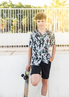 Smiling young man with skateboard