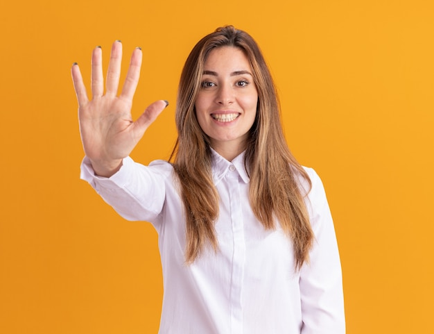 Smiling young pretty caucasian girl gestures five