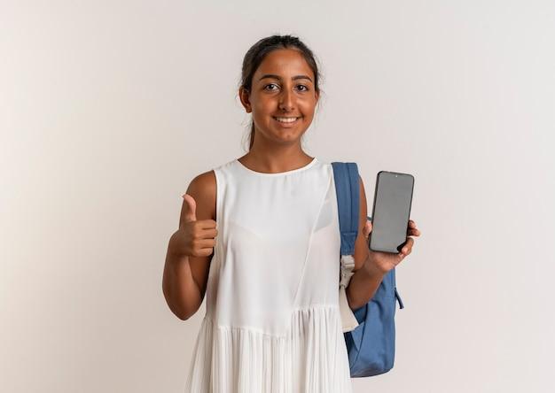 電話を保持しているバックバッグを身に着けている若い女子高生の笑顔