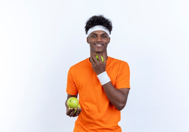Smiling young sporty man wearing headband