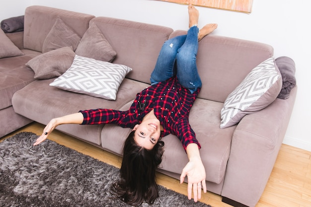Smiling young woman messing around in the living room