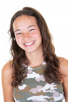 Smiling young woman teenage girl in army shirt over white background