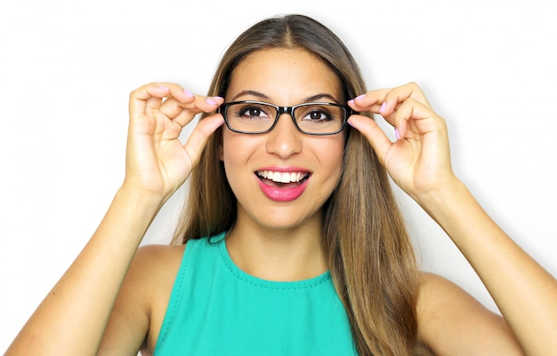 Smiling young woman wearing glasses and holding frame