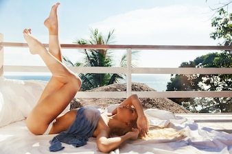 Smiling young woman with beautiful legs resting on a sunny day