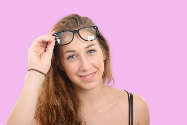 Smiling young woman with black glasses