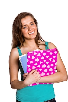 Smiling young woman with books
