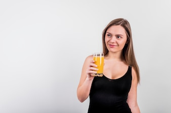 Smiling young woman with glass of juice