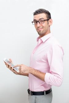 Smirking business man using tablet computer