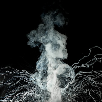 Smoke as from a volcano on black background.