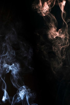 Smoke blowing abstract on the corner of the dark background
