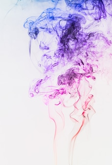 Smoke colorful floating in the air on white background