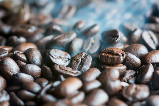 Smoke comes from roasted fragrant coffee beans aroma, on frying pan