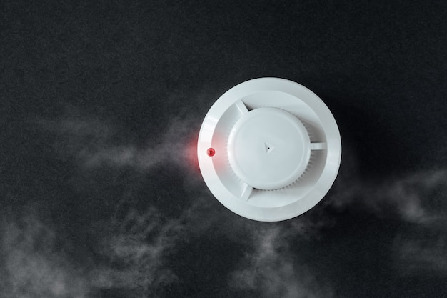 Smoke detector and fire detector on a black background