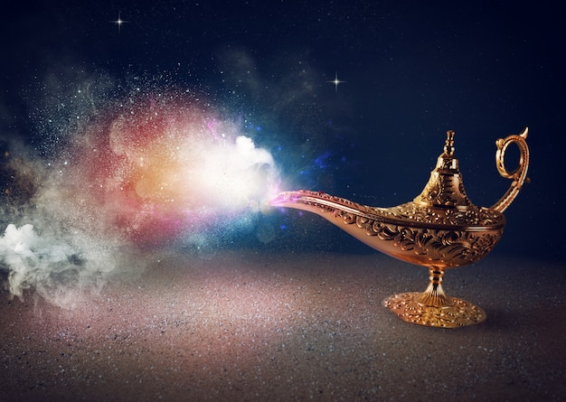 Smoke exists from magic genie lamp in a desert